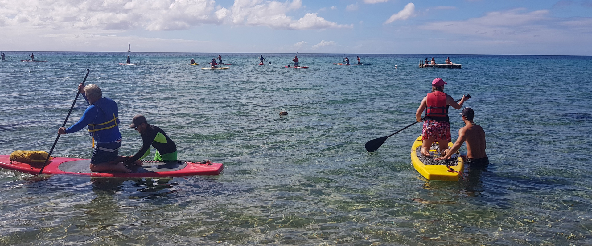 Group on Stand Up Paddle Board Tour in St. Kitts and Nevis