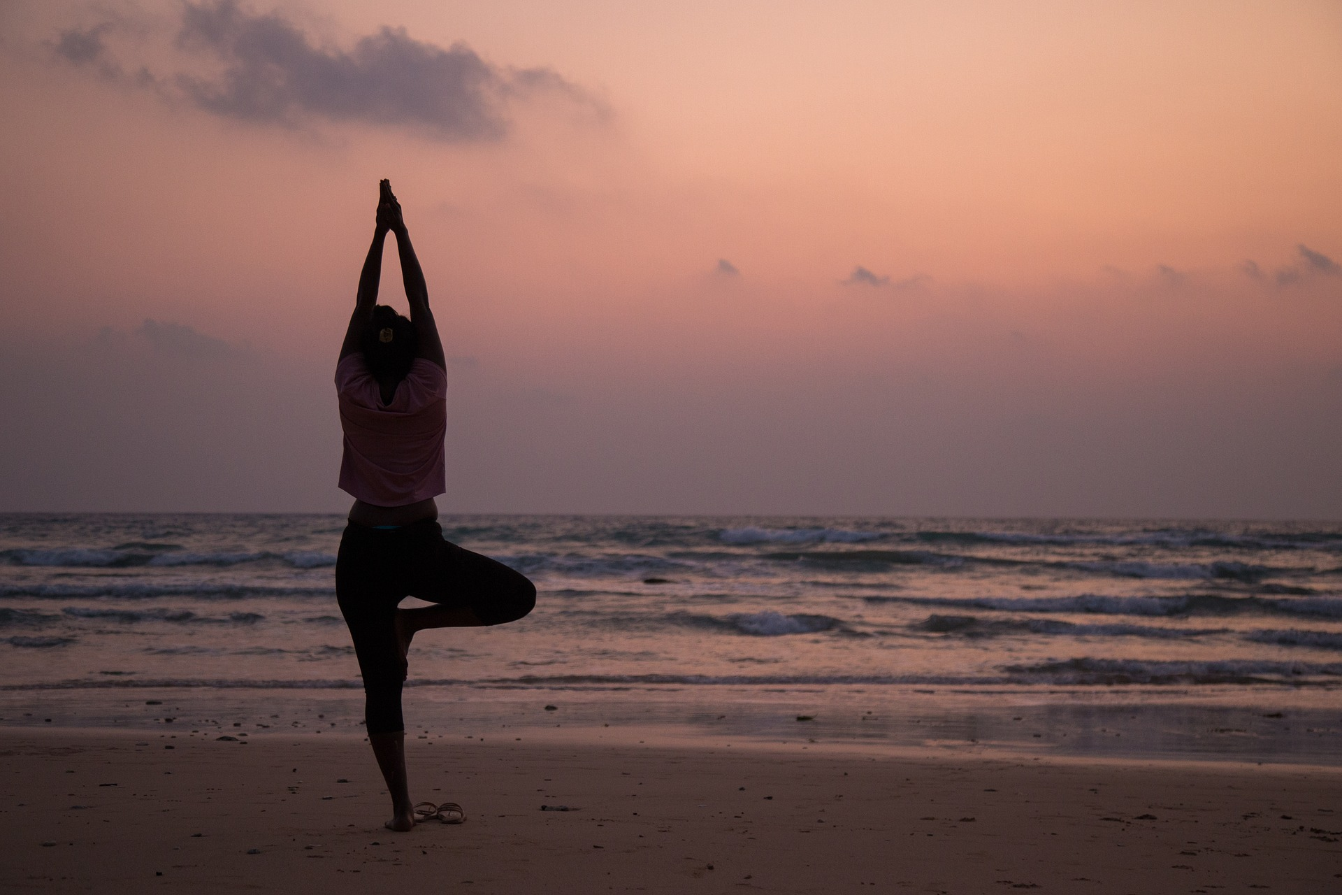 Woman Practicing Yoga on the Beach in St. Kitts